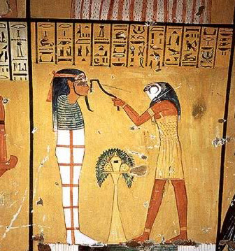 Heru holding sba ur instrument to mouth of mummy